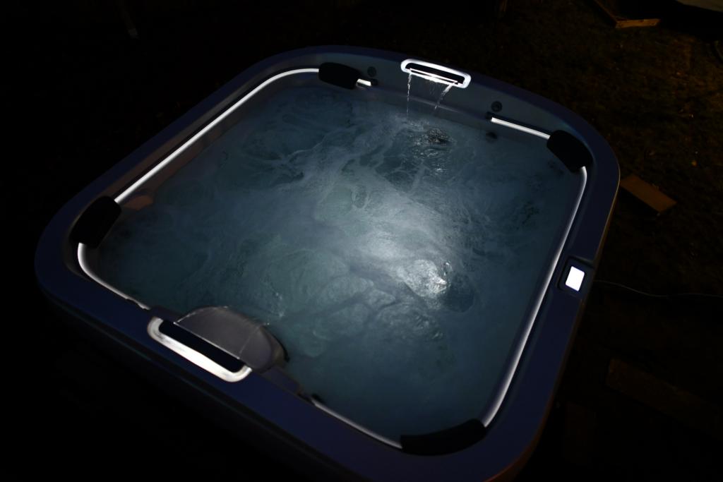 Illuminated Jacuzzi Hot Tub at night.