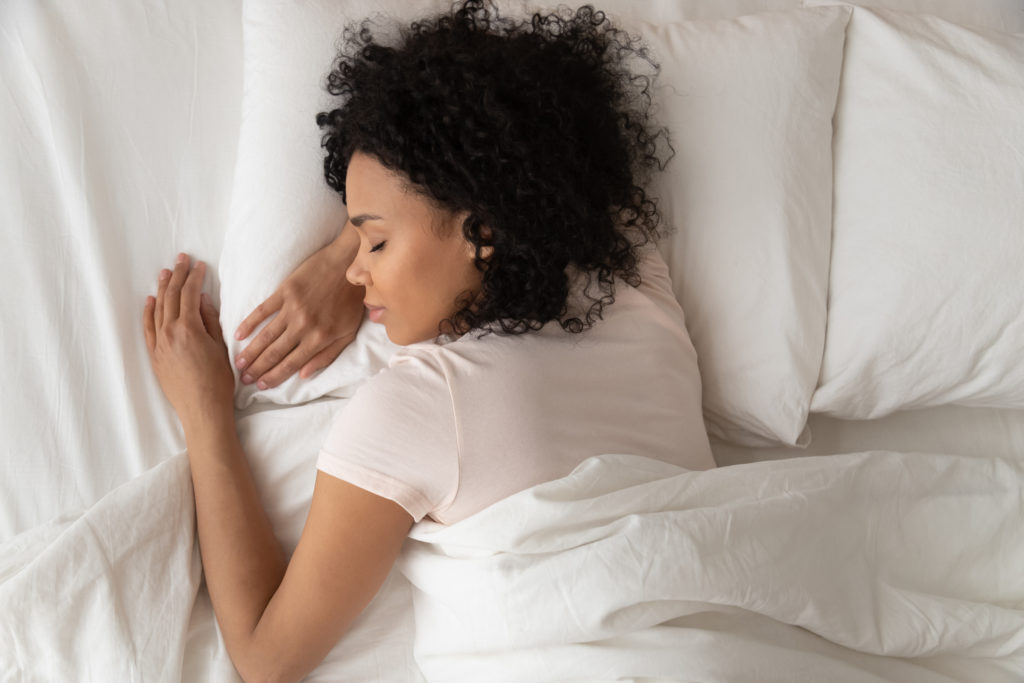 Woman sleeping peacefully in bed.